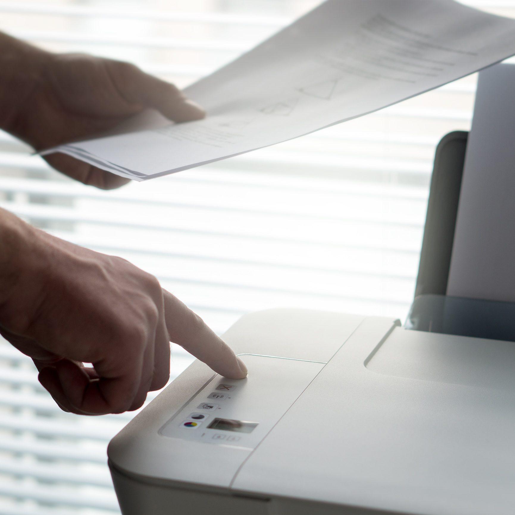 man faxing paper