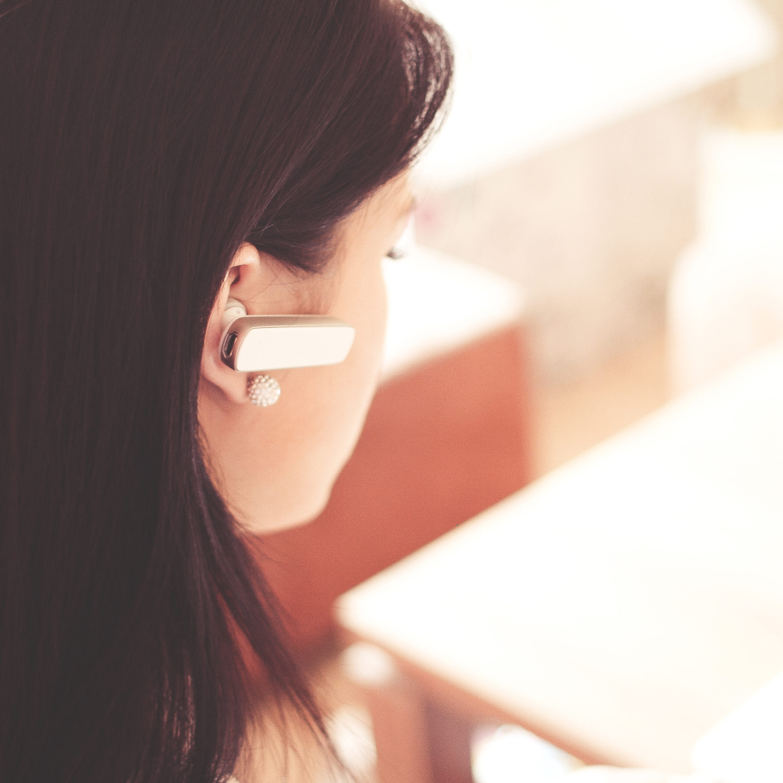 woman with bluetooth in her ear