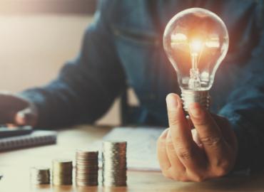 light bulb and money